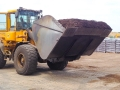 Front loader bringing mulch to be bagged