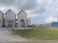 Leaving Dauphin Island cute houses.